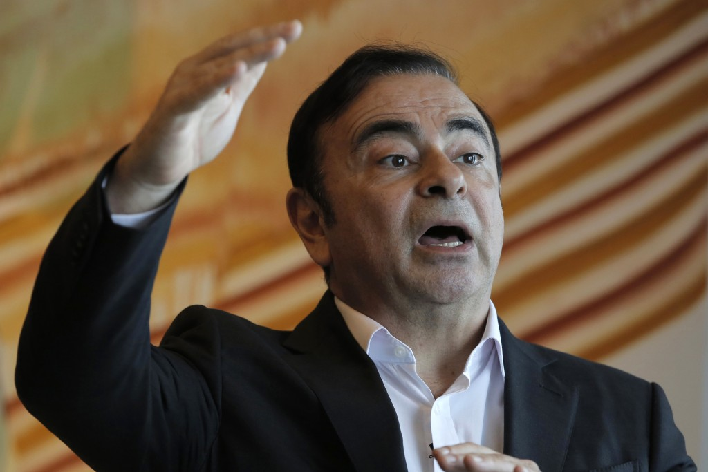 FILE - In this Friday, April 20, 2018, file photo, Nissan Chairman Carlos Ghosn speaks during an interview in Hong Kong. The criminal trial against Ja...
