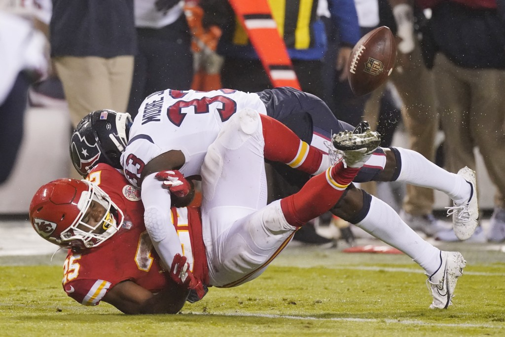 Kansas City Chiefs running back Clyde Edwards-Helaire (25) loses the ball as he is hit by Houston Texans safety A.J. Moore Jr. (33) in the second half...