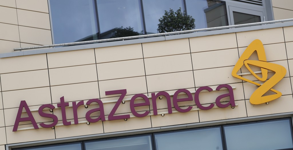 FILE - This Saturday, July 18, 2020 file photo shows a general view of AstraZeneca offices and the corporate logo in Cambridge, England. Late stage tr...