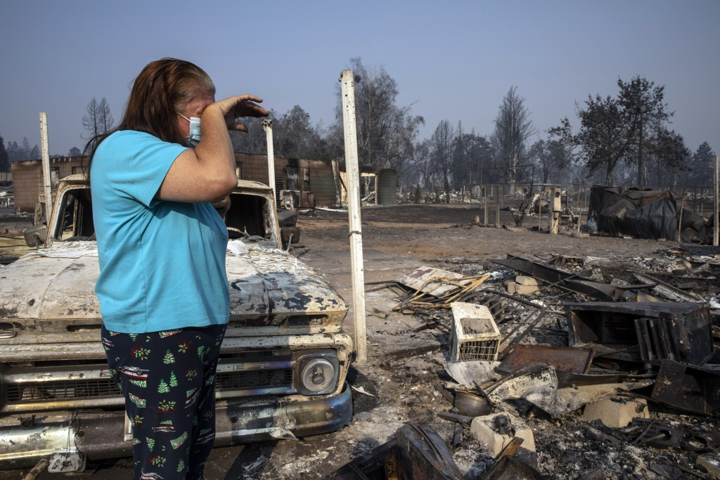 Heather Marshall stands by the destruction of her home at Coleman Creek Estates mobile home park in Phoenix, Ore., Thursday, Sept. 10, 2020. The area ...