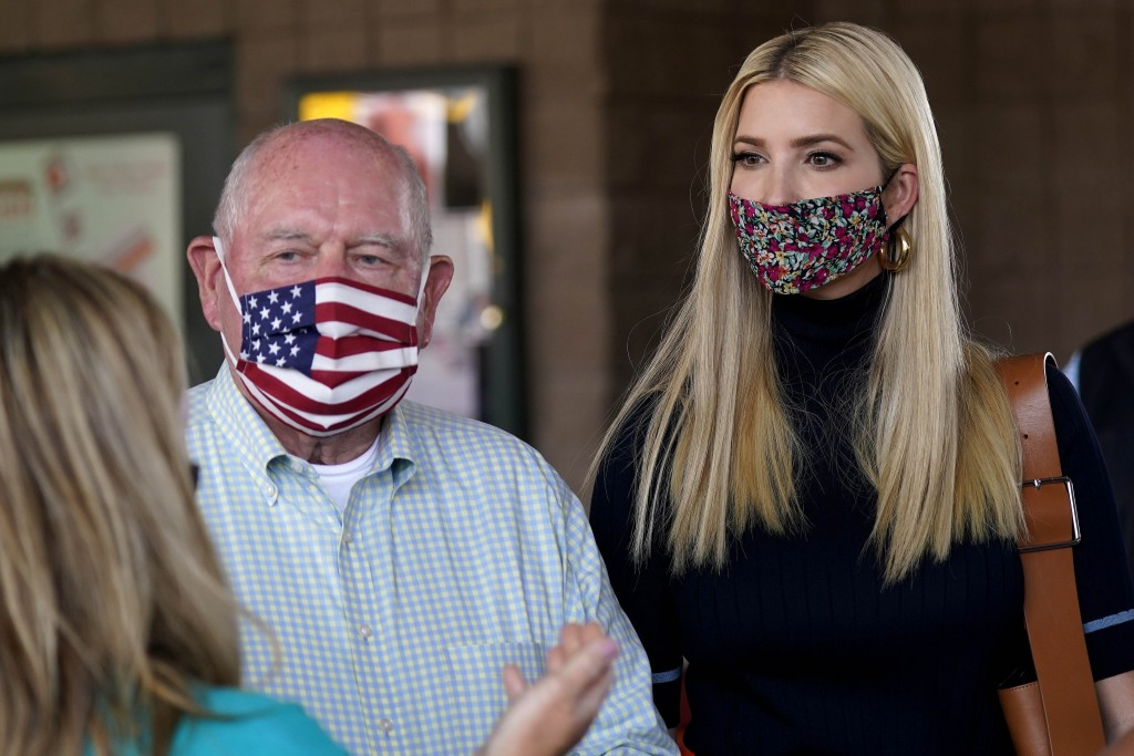 Ivanka Trump, right, and Secretary of Agriculture Sonny Perdue, left, speak with a farming family during a visit to the North Carolina State Farmers M...