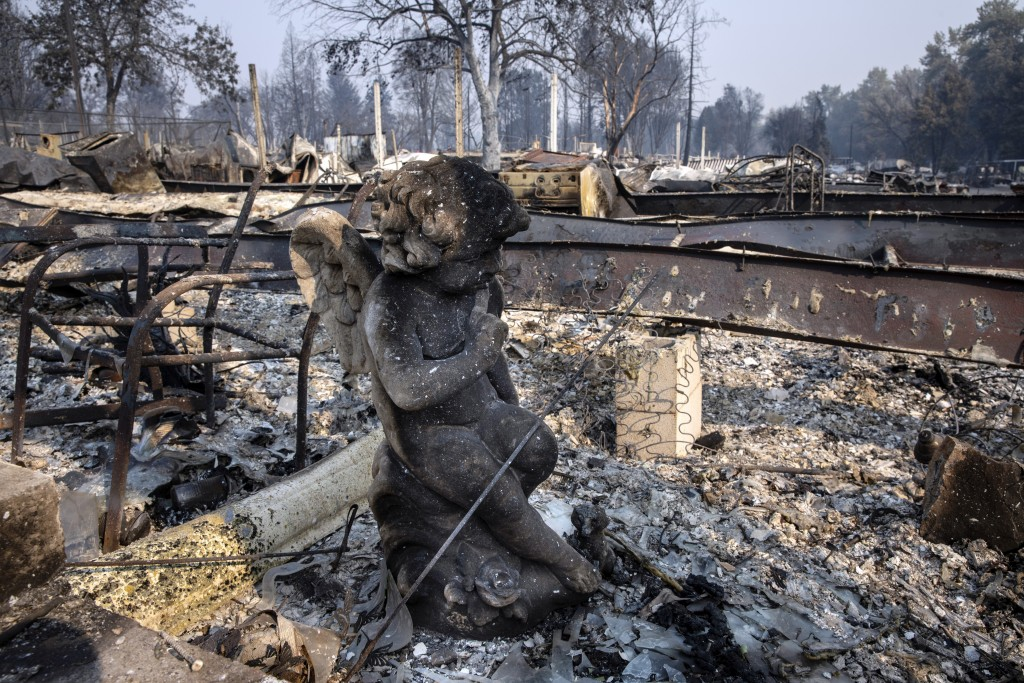 A charred statue sits among the destruction at Coleman Creek Estates mobile home park in Phoenix, Ore., Thursday, Sept. 10, 2020. The area was destroy...