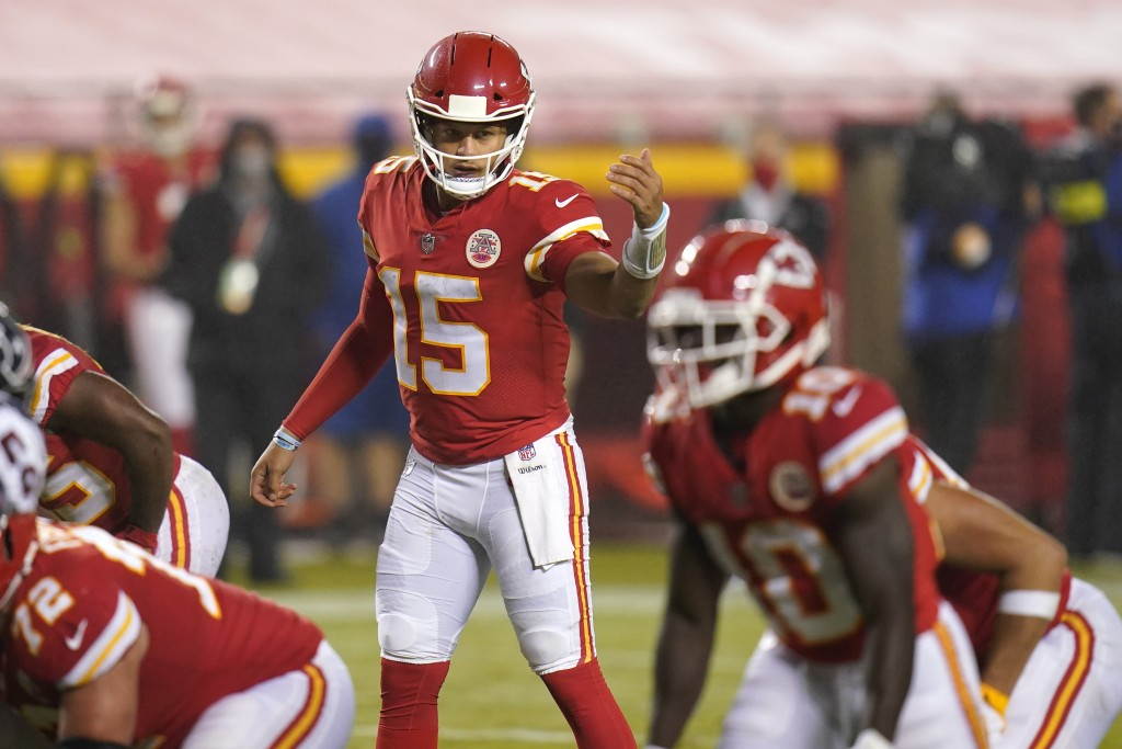 Kansas City Chiefs quarterback Patrick Mahomes (15) directs a teammate in the second half of an NFL football game against the Houston Texans Thursday,...