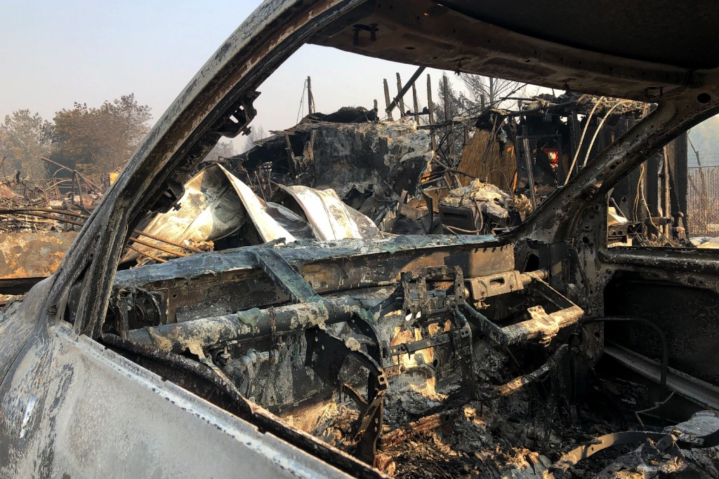 The interior of a vehicle is melted among the ruins of the Coleman Creek Estates mobile home park in Phoenix, Ore., Thursday, Sept. 10, 2020. The area...