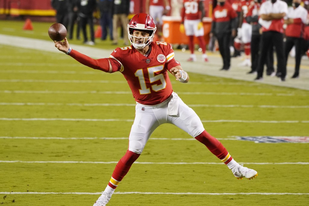 Kansas City Chiefs quarterback Patrick Mahomes passes against the Houston Texans in the first half of an NFL football game Thursday, Sept. 10, 2020, i...