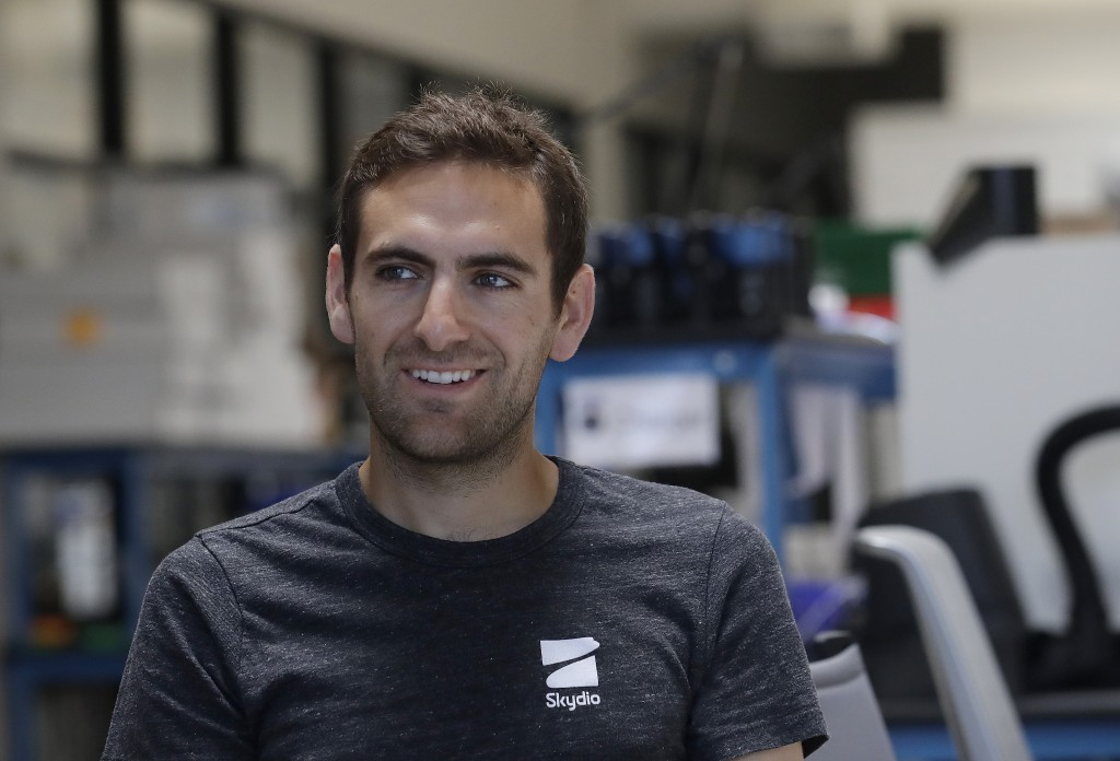 In this June 22, 2018, photo, Adam Bry, founder and CEO of Skydio, is interviewed in Redwood City, Calif. Skateboarders, surfers and YouTube stars use...