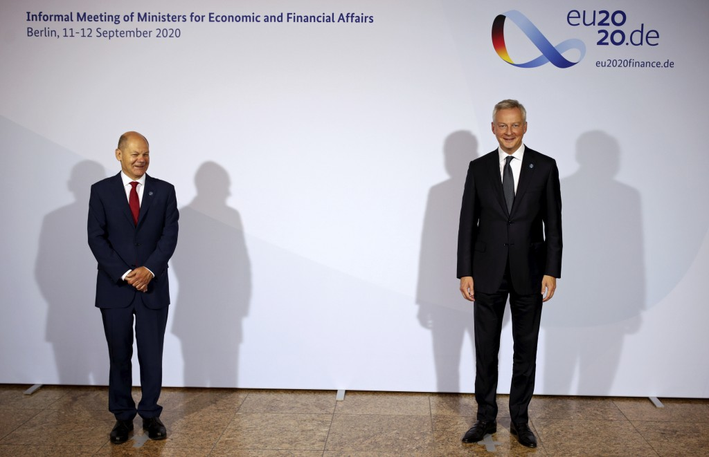 French Finance and Economy Minister Bruno Le Maire, right, is welcomed by Federal Finance Minister Olaf Scholz, left, for the Informal Meeting of Econ...