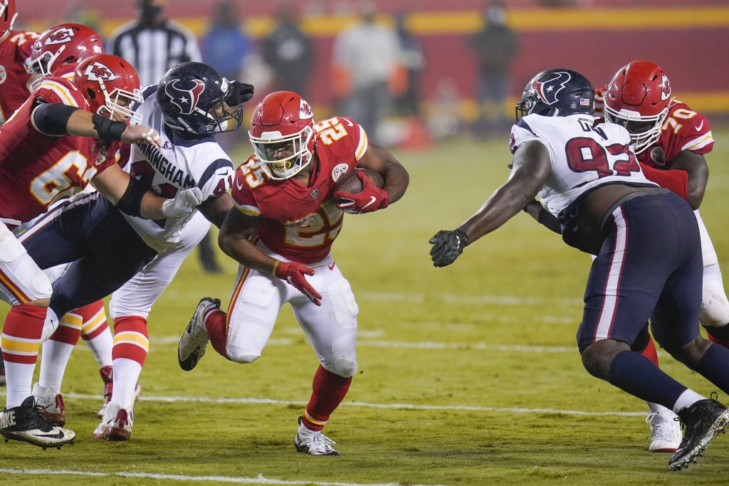 Kansas City Chiefs running back Clyde Edwards-Helaire (25) carries the ball against the Houston Texans in the second half of an NFL football game Thur...