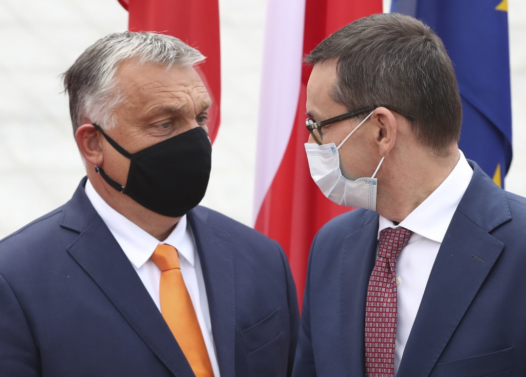 Poland's Prime Minister Mateusz Morawiecki, right, is greeting his counterpart from Hungary, Viktor Orban, left, at the start of the Visegrad Group pr...