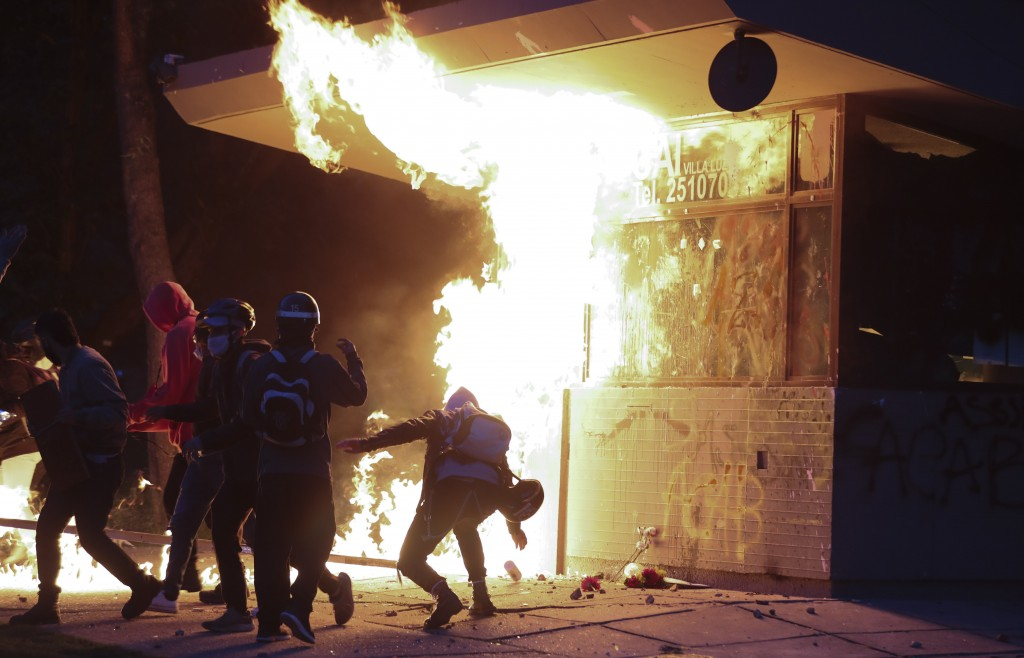 Demonstrator sets on fire a police post during protests against the death of a man who was detained by police for violating social distancing rules to...