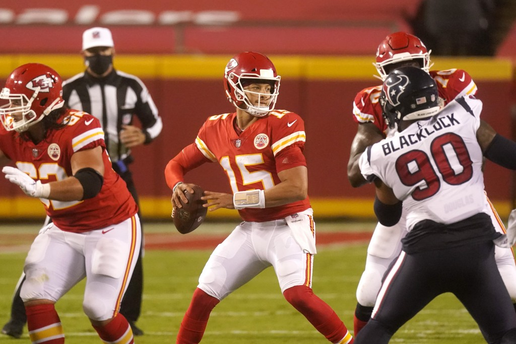 Kansas City Chiefs quarterback Patrick Mahomes (15) passes against the Houston Texans in the first half of an NFL football game Thursday, Sept. 10, 20...