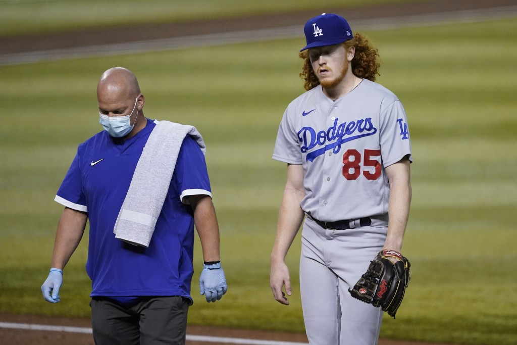 Los Angeles Dodgers starting pitcher Dustin May (85) is pulled from the baseball game during the second inning against the Arizona Diamondbacks, Thurs...