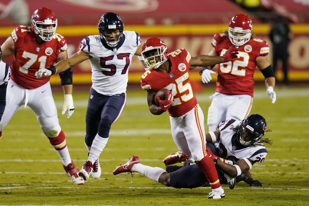 Kansas City Chiefs running back Clyde Edwards-Helaire (25) carries the ball against the Houston Texans in the first half of an NFL football game Thurs...