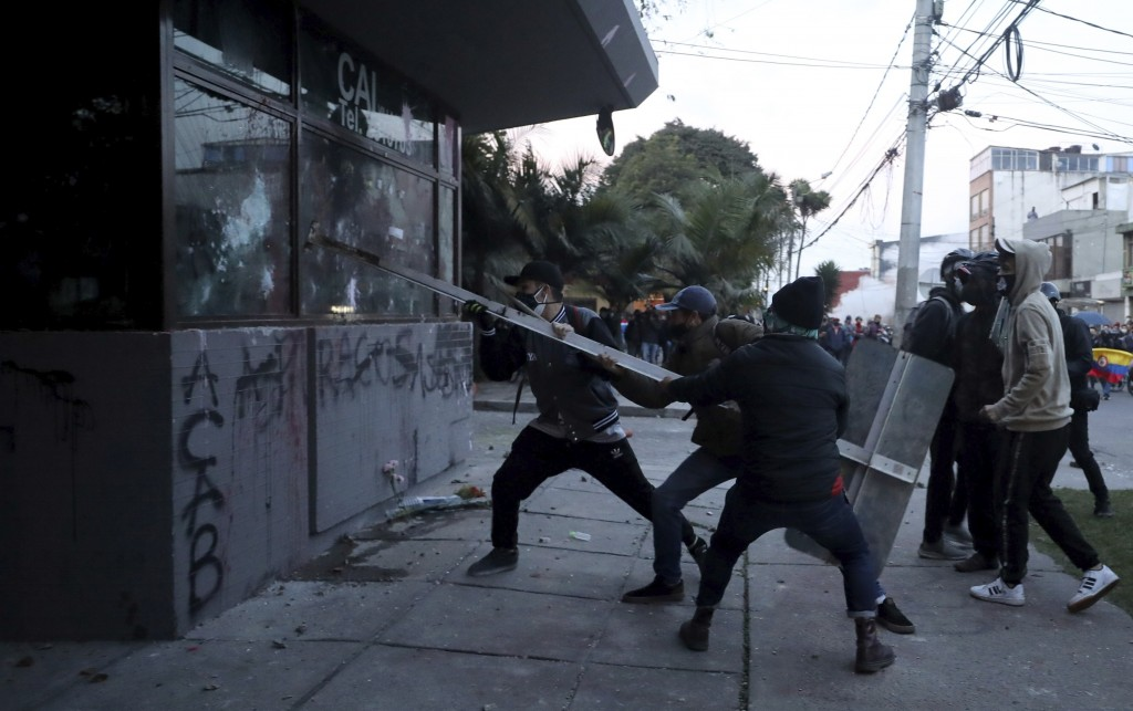 Demonstrators attack a police post during protests against the death of a man who was detained by police for violating social distancing rules to curb...