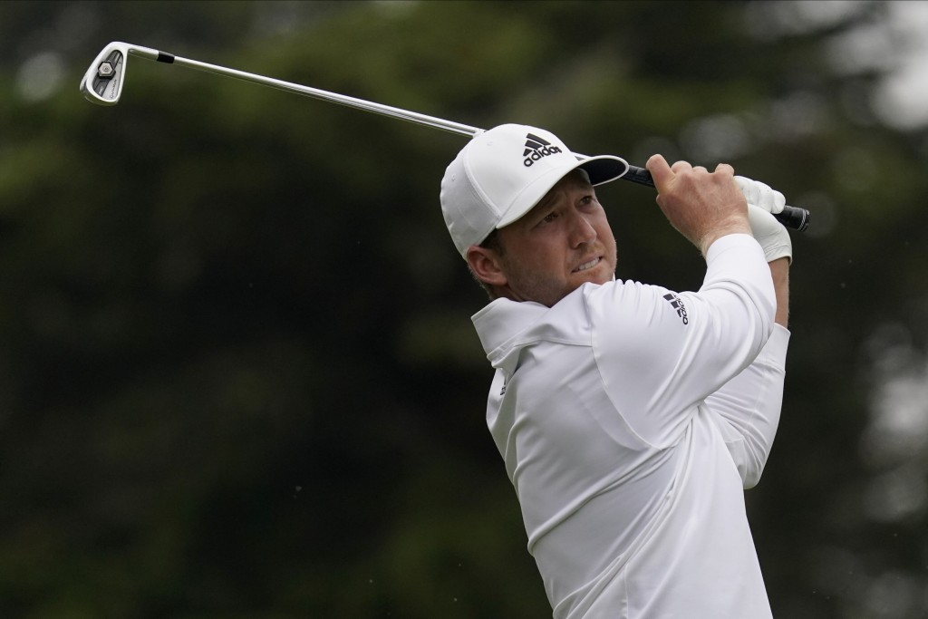 FILE - In this Aug. 9, 2020, file photo, Daniel Berger watches his tee shot on the third hole during the final round of the PGA Championship golf tour...