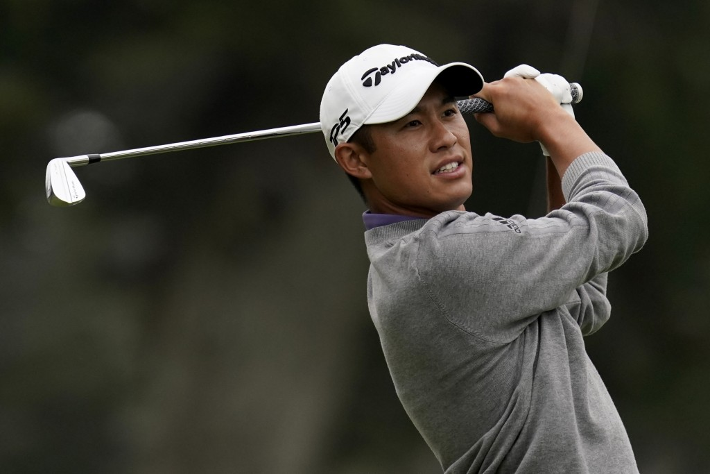 FILE - In this Aug. 9, 2020, file photo, Collin Morikawa watches his tee shot on the third hole during the final round of the PGA Championship golf to...