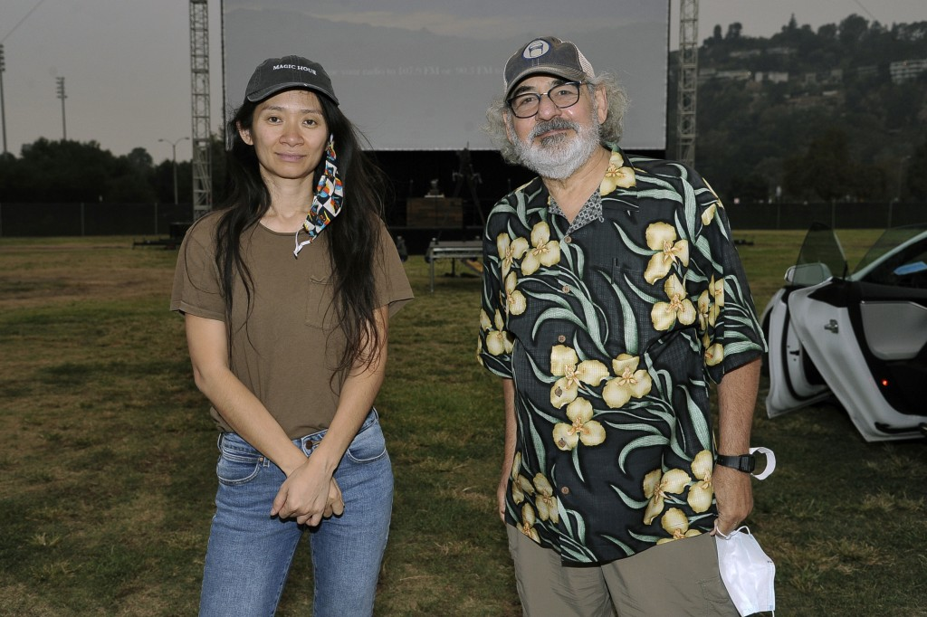 "Chloe Zhao, left, and Stephen Gilula attend the Telluride from Los Angeles drive-in screening of ""Nomadland"" on Friday, Sept. 11, 2020, at the Rose Bo..."
