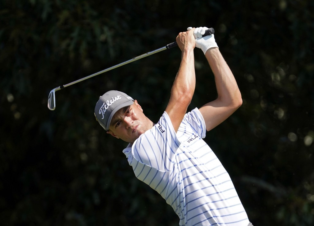 FILE - In this Sept. 6, 2020, file photo, Justin Thomas hits from the tee on the third hole during the third round of play in the Tour Championship go...