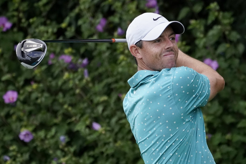 FILE - In this Aug. 30, 2020, file photo, Rory McIlroy, of Northern Ireland, hits from the first tee during the final round of the BMW Championship go...