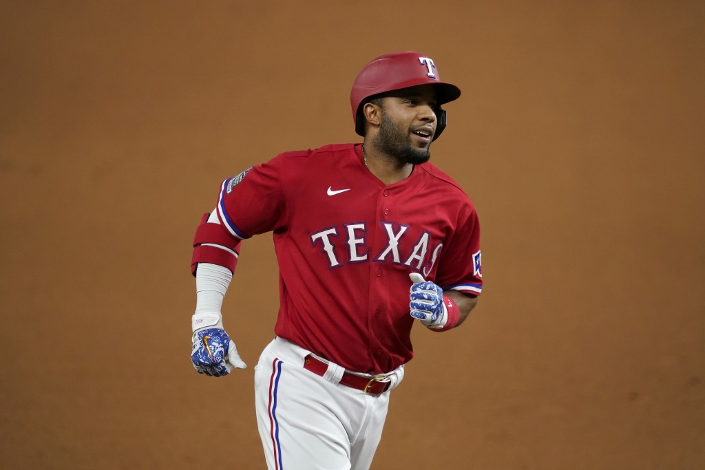 Texas Rangers' Elvis Andrus rounds third on his way home after hitting a solo home run against the Oakland Athletics in the seventh inning of a baseba...