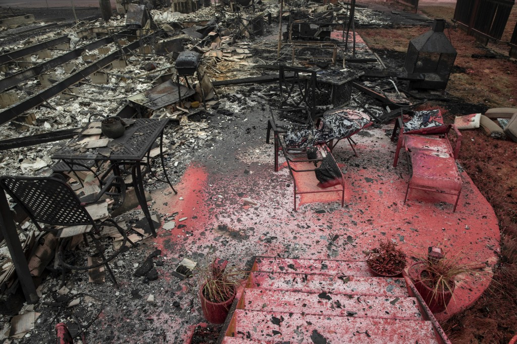 A burned residence is seen as destructive wildfires devastate the region on Friday, Sept. 11, 2020, in Talent, Ore. (AP Photo/Paula Bronstein)