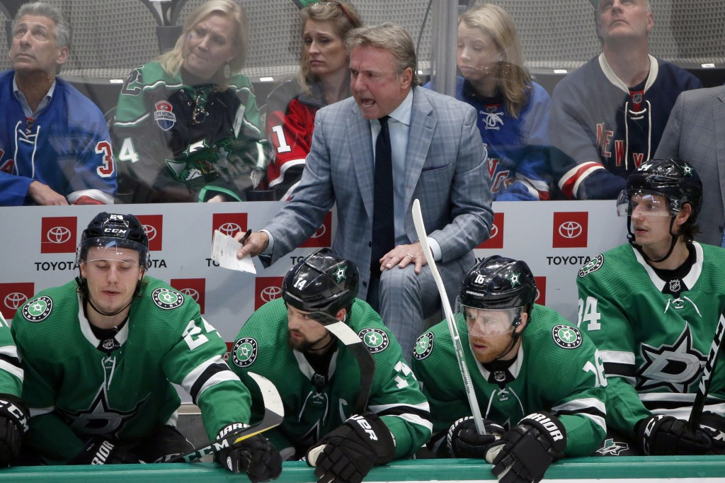 FILE - In this March 10, 2020, file photo, Dallas Stars interim head coach Rick Bowness yells from the bench as they played the New York Rangers durin...