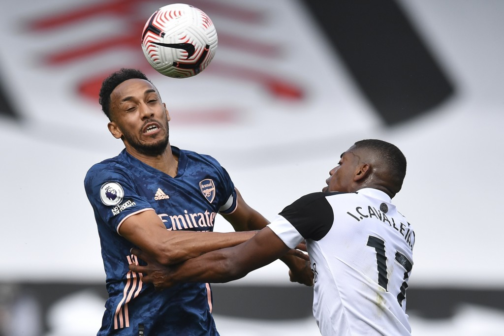 Arsenal's Pierre-Emerick Aubameyang, left, and Fulham's Ivan Cavaleiro vie for the ball during the English Premier League soccer match between Fulham ...