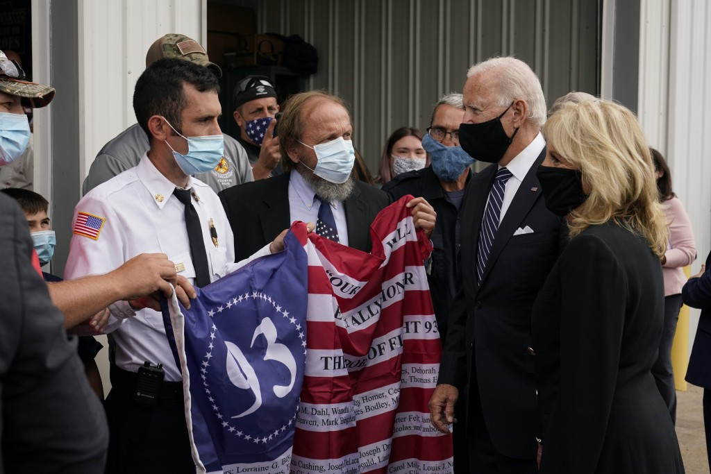 Members of the Shanksville Volunteer Fire Department present a flag to Democratic presidential candidate and former Vice President Joe Biden and his w...