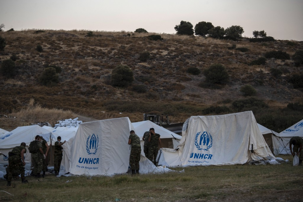 Greek soldiers set up UNHCR tents at a shooting range to accommodate refugees, in Lesbos Island, Greece, Friday, Sept. 11, 2020. Some thousands of ref...