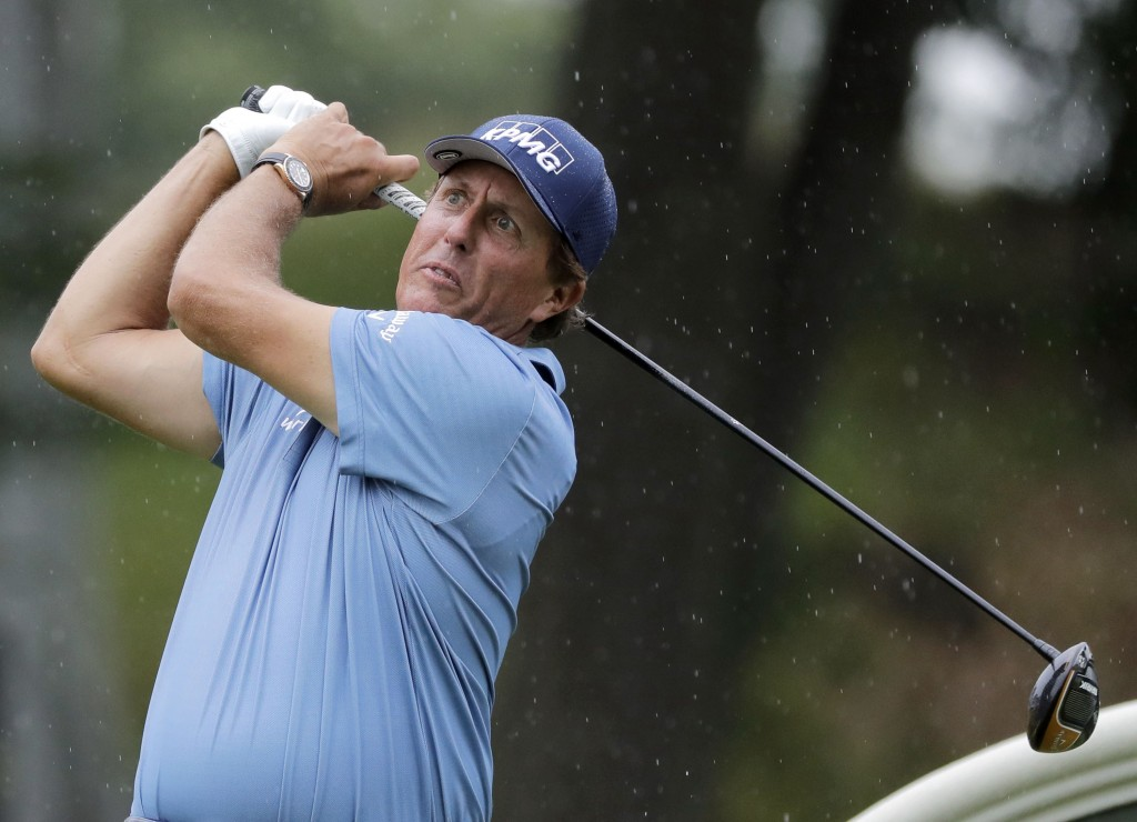 FILE - In this June 27, 2020, file photo, Phil Mickelson tees off on the 18th hole during the third round of the Travelers Championship golf tournamen...