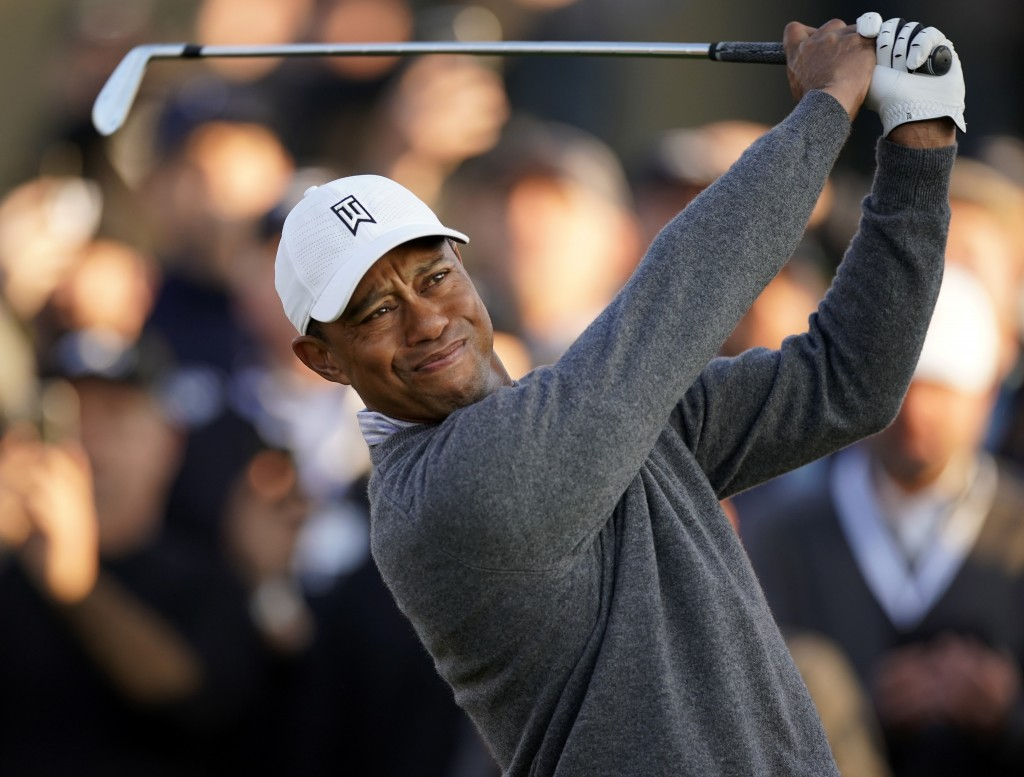 FILE - In this Feb. 14, 2020, file photo, Tiger Woods tees off on the 10th hole during the second round of the Genesis Invitational golf tournament at...