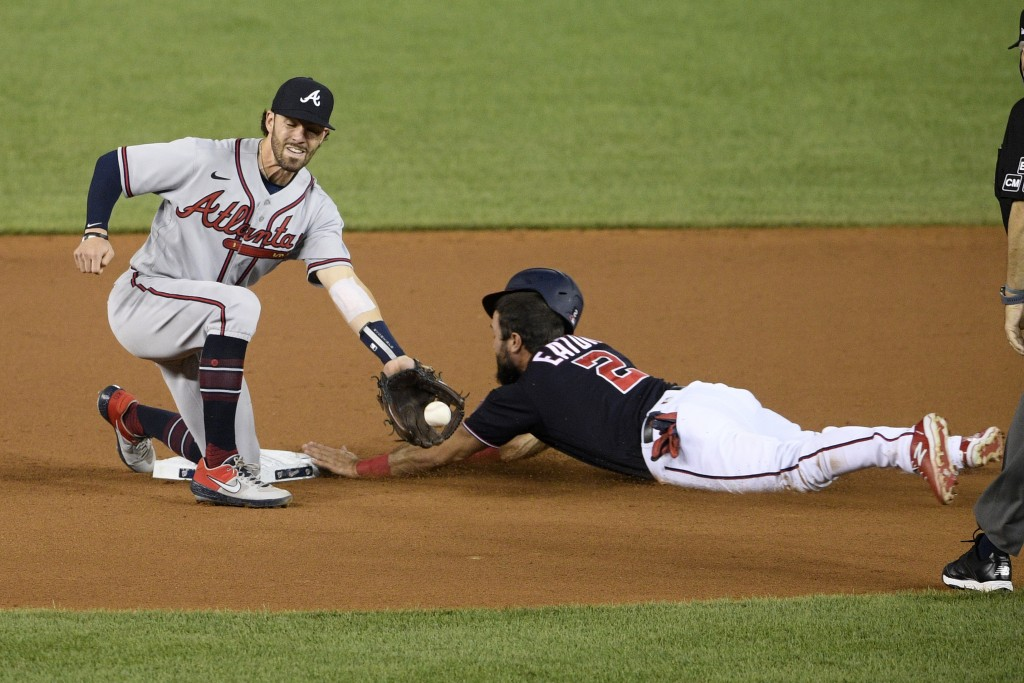 Washington Nationals' Adam Eaton steals second against Atlanta Braves shortstop Dansby Swanson, left, during the eighth inning of a baseball game, Sat...