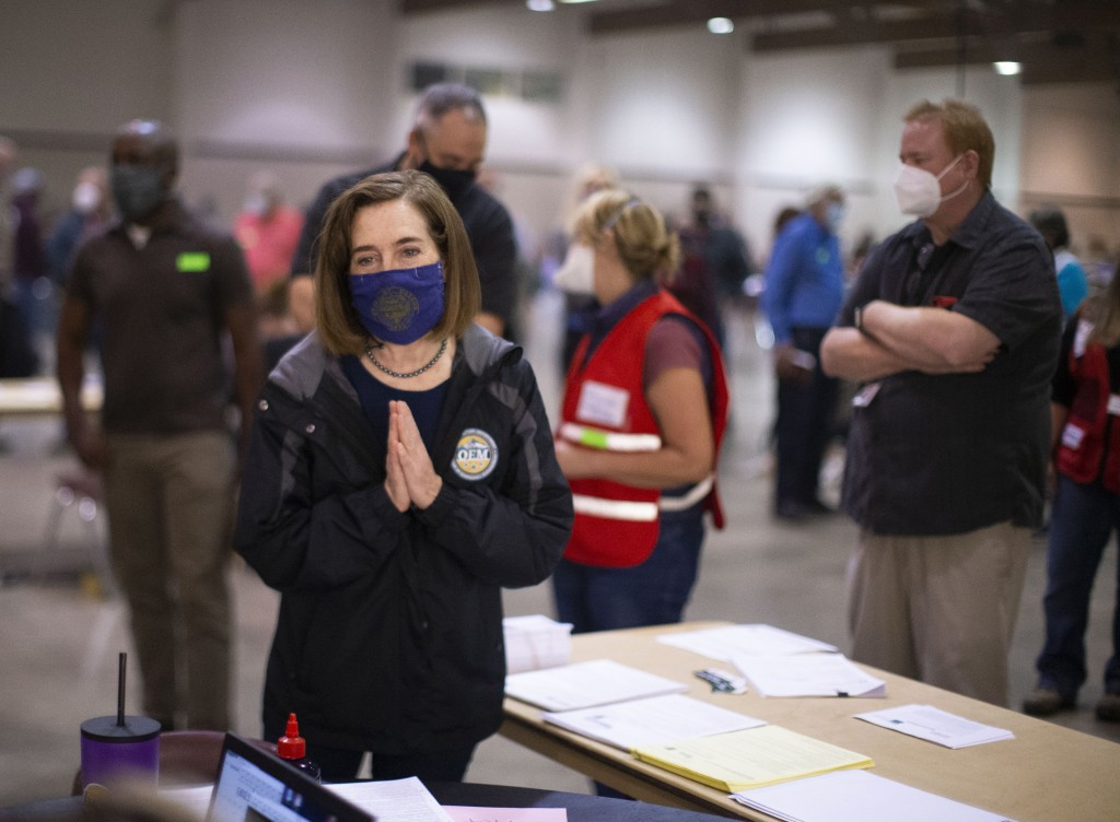 Oregon Governor Kate Brown toured the Oregon State Fairgrounds in Salem, Ore., Saturday afternoon, Sept. 12, 2020, where she spoke with volunteers and...