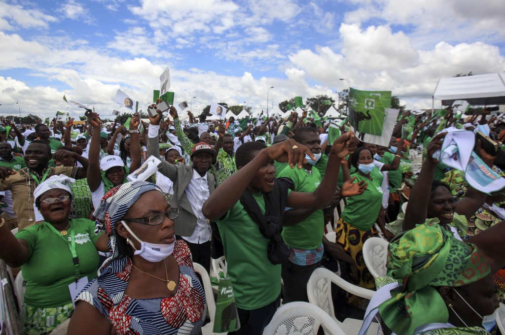 Supporters gather at a party rally to celebrate the presidential candidacy of Henri Konan Bedie for the opposition PDCI-RDA party and as a show of str...