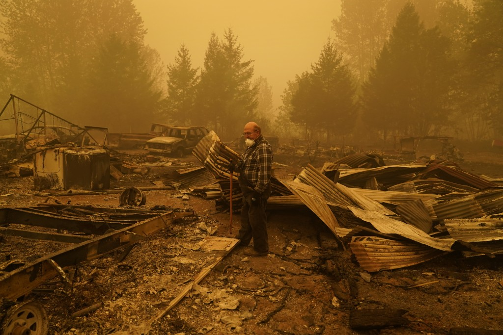 George Coble walks through what remains of a home on his property destroyed by a wildfire Saturday, Sept. 12, 2020, in Mill City, Ore. (AP Photo/John ...