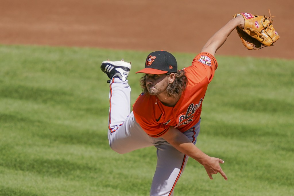 Baltimore Orioles starting pitcher Dean Kremer throws in the first inning of a baseball game against the New York Yankees, Saturday, Sept. 12, 2020, i...
