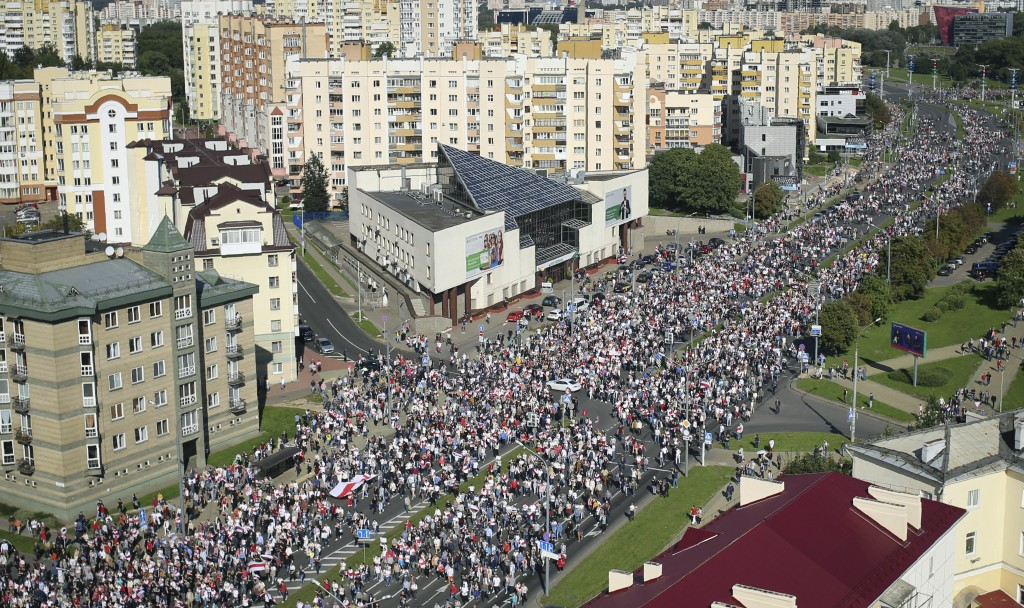 Protesters march during an opposition supporters rally in Minsk, Belarus, Sunday, Sept. 13, 2020. Protests calling for the Belarusian president's resi...