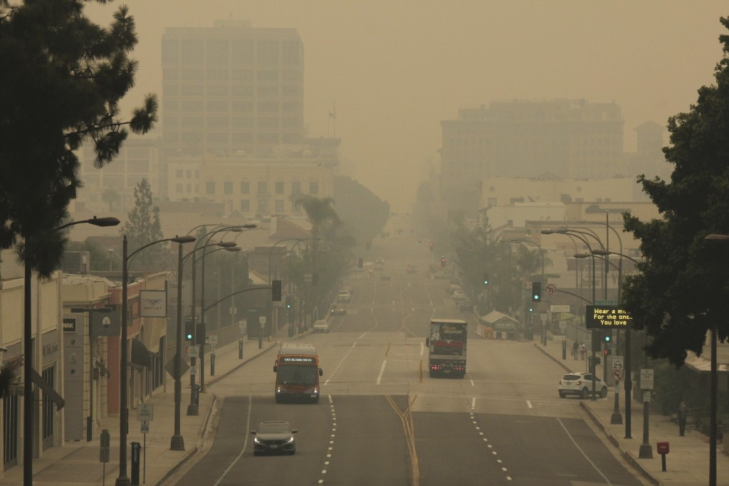 Smoke from wildfires fills the sky over Pasadena, Calif., in this view looking east down Colorado Boulevard on Saturday, Sept. 12, 2020. The air was c...