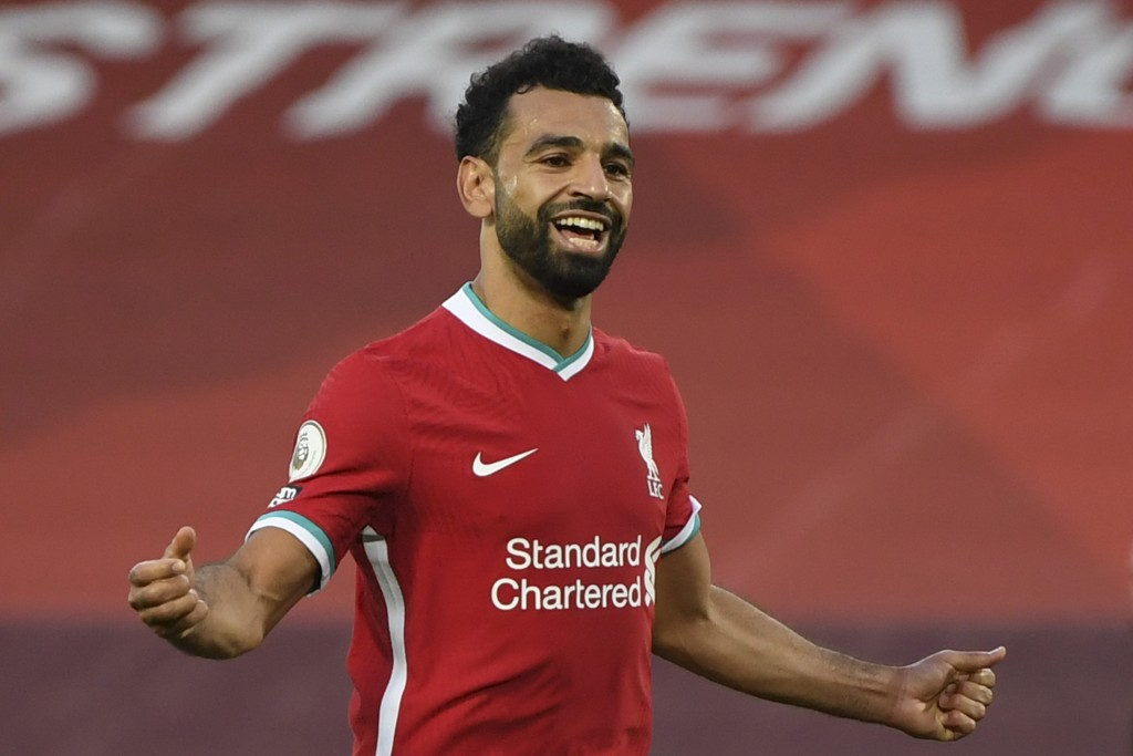 Liverpool's Mohamed Salah celebrates after he scored his side's fourth goal during the English Premier League soccer match between Liverpool and Leeds...