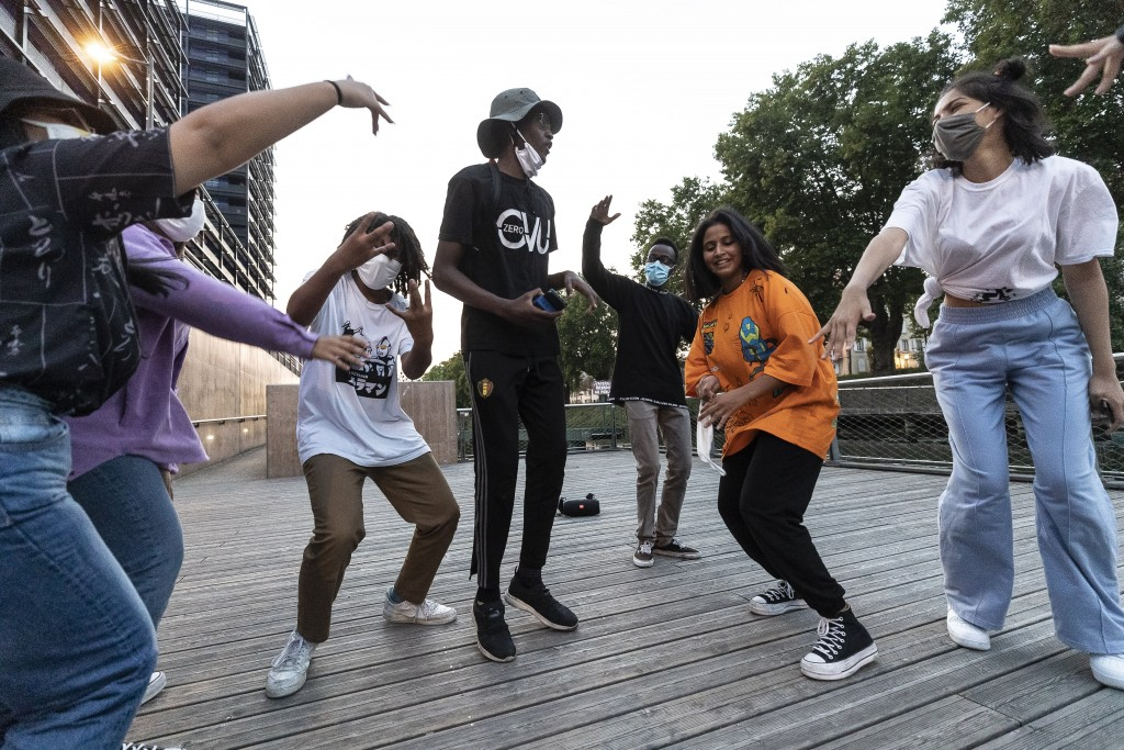 "People dance wearing face masks in Strasbourg, eastern France, Friday Sept.11, 2020. In a speech urging the public to stay ""vigilant"", French Prime Mi..."