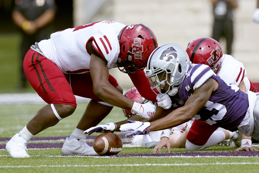 Kansas State defensive back D.J. Render (23) recovers an on-side kick during the first half of an NCAA college football game against Arkansas State Sa...