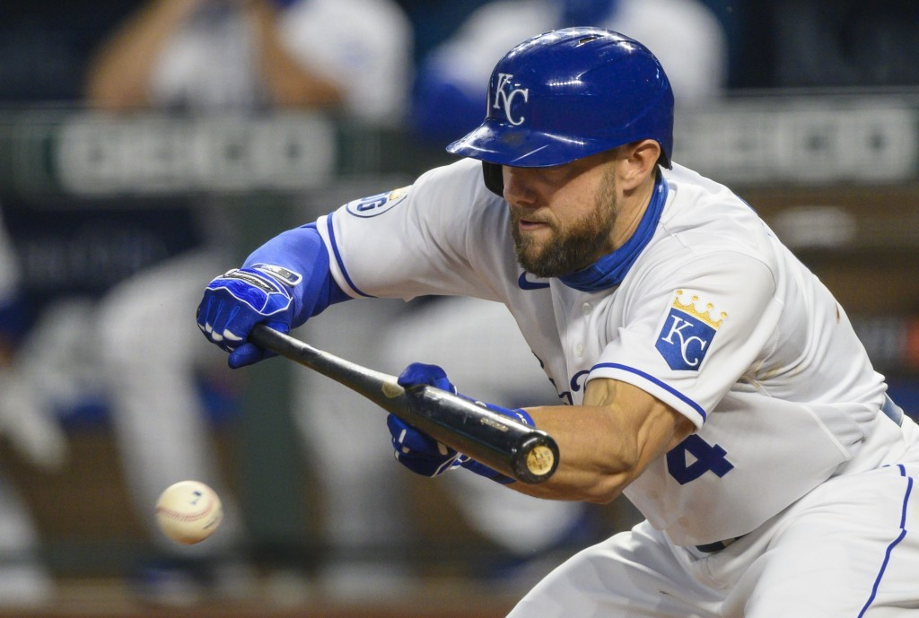 Kansas City Royals' Alex Gordon bunts during the third inning of a baseball game against the Pittsburgh Pirates in Kansas City, Mo., Saturday, Sept. 1...