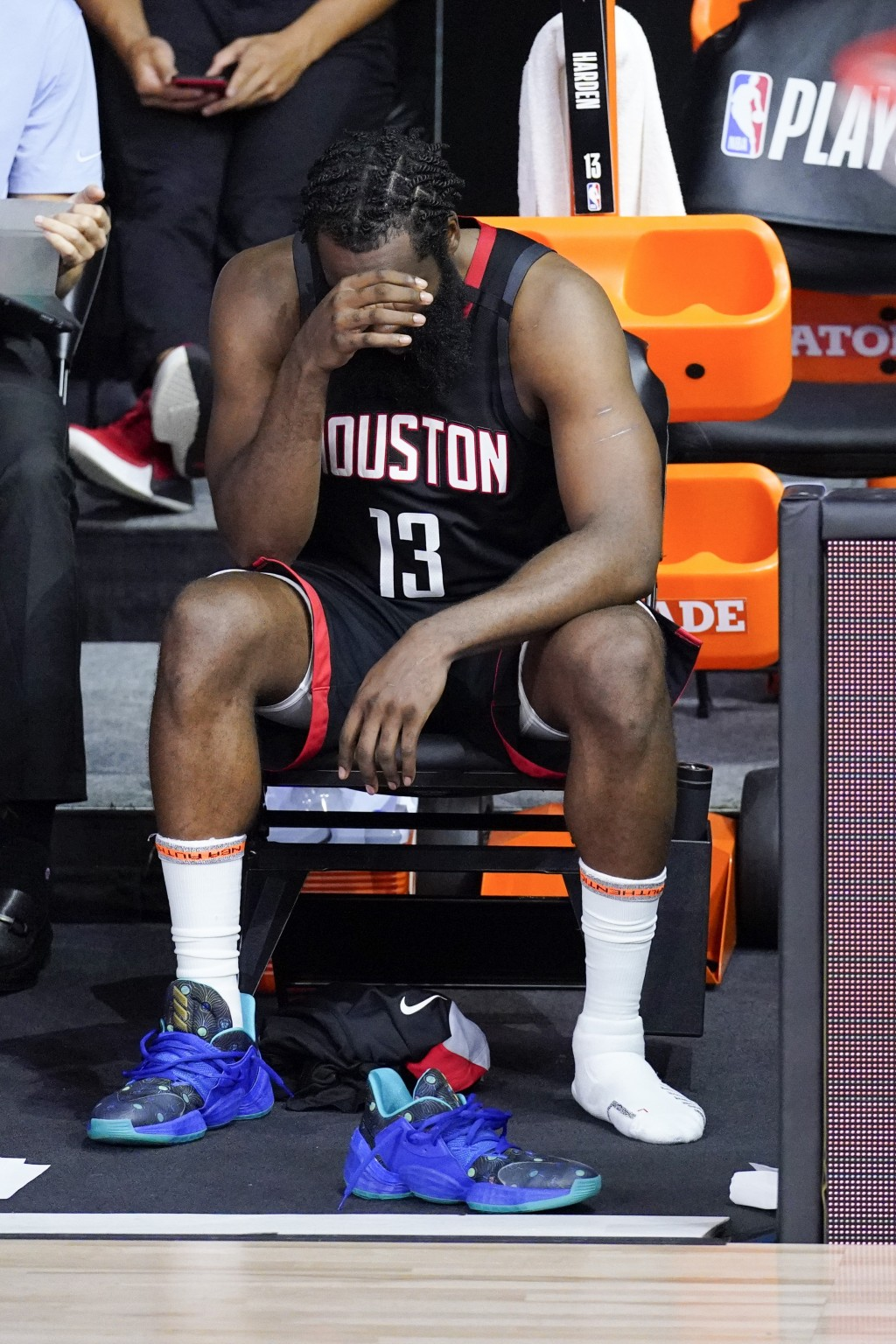 Houston Rockets' James Harden cover his face in the closing minutes of a loss to the Los Angeles Lakers during the second half of an NBA conference se...