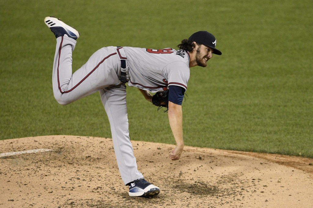 Atlanta Braves starting pitcher Ian Anderson follows through on a pitch during the fifth inning of a baseball game against the Washington Nationals, S...
