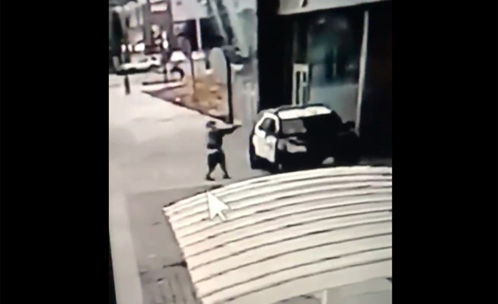 A screen grab from a security camera video released the Los Angeles County Sheriff's Department shows a gunman walking up to sheriff's deputies and op...