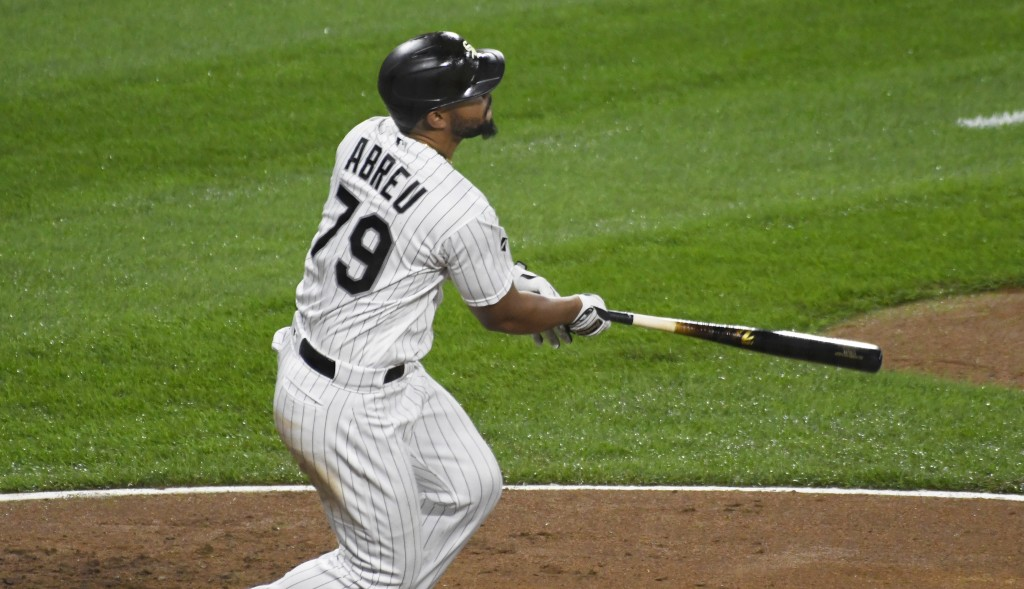 Chicago White Sox's Jose Abreu (79) watches his three-run home run against the Detroit Tigers during the fourth inning of a baseball game, Saturday, S...
