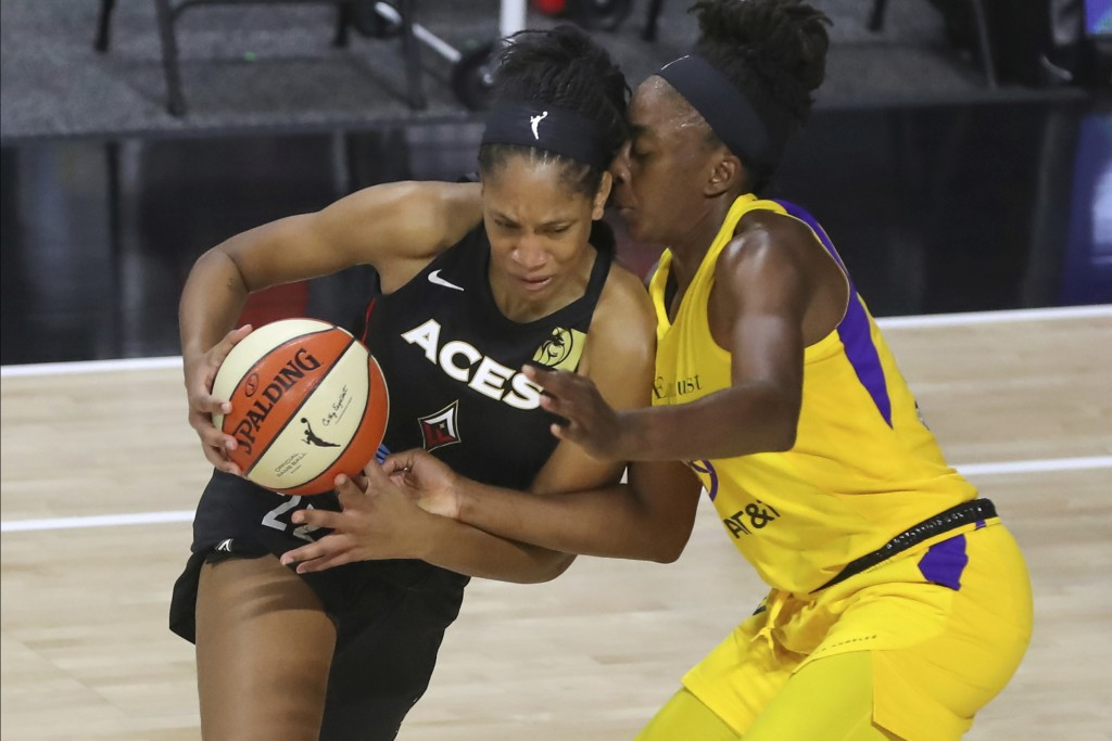 Las Vegas Aces' A'ja Wilson, left, drives against Los Angeles Sparks' Nneka Ogwumike during the first half of a WNBA basketball game Saturday, Sept. 1...