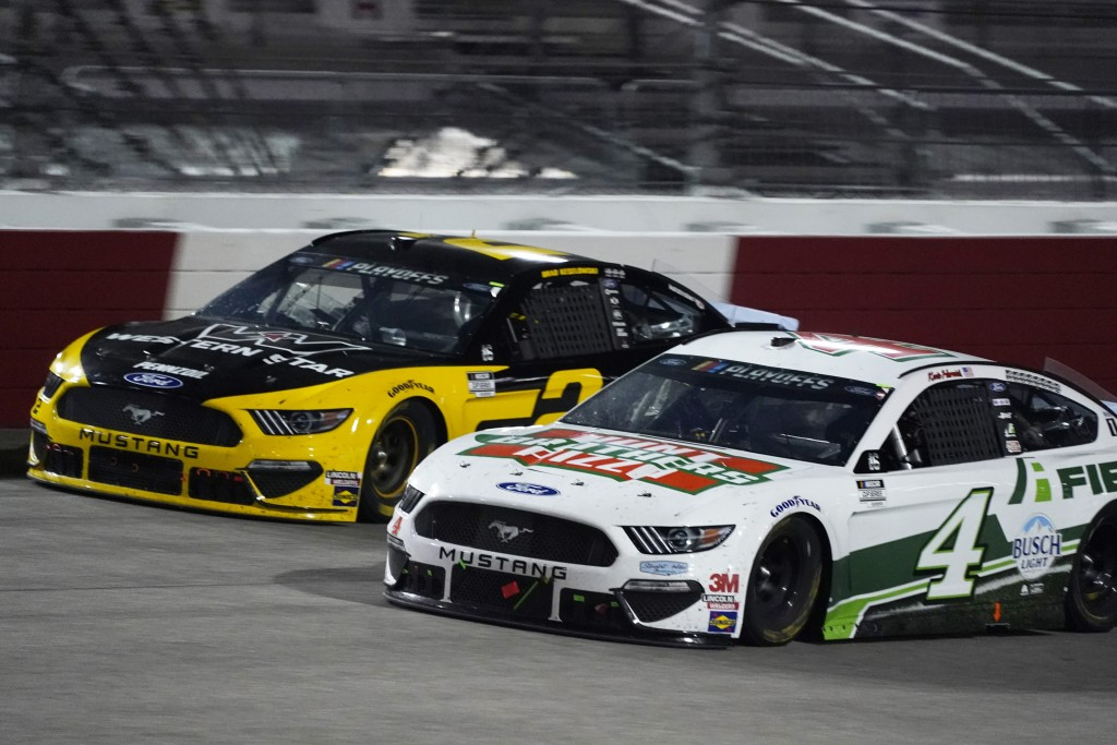 Brad Keselowski (2) and Kevin Harvick (4) drive into turn one during a NASCAR Cup Series auto race Saturday, Sept. 12, 2020, in Richmond, Va. (AP Phot...