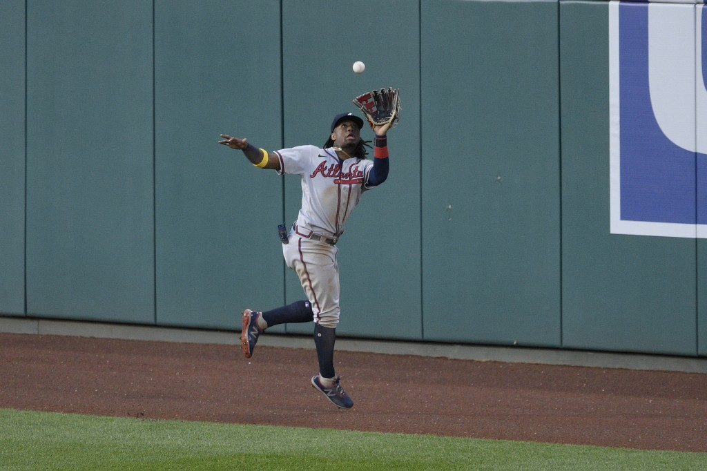 Atlanta Braves center fielder Ronald Acuna Jr. jumps and makes the catch on a line drive by Washington Nationals' Trea Turner during the third inning ...