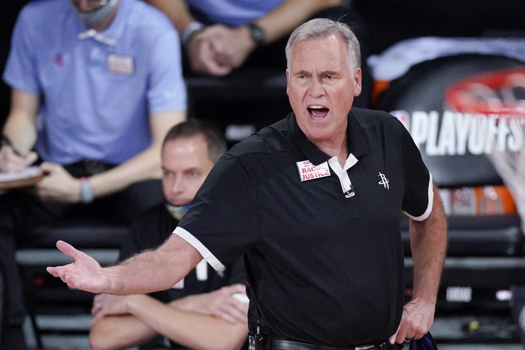 Houston Rockets head coach Mike D'Antoni yells from the bench during the second half of an NBA conference semifinal playoff basketball game against th...